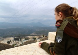 An Israeli soldier looking over the city of Tzvat