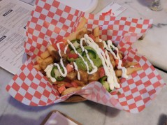 Le Mexicain: traditional Poutine with Jalapeño Peppers, Tomato, Sour Cream, and Guacamole (surprisingly tasty)!