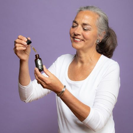 woman using tincture