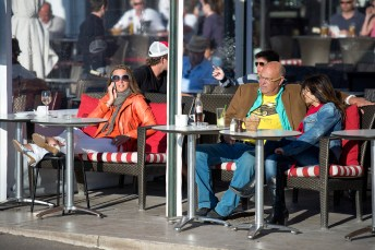 Soaking up the sun in a quay-side cafe, possibly Cecil or Cafe de Paris.