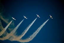 Four Snowbirds rising