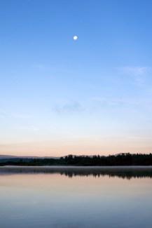 A dead calm Dragon Lake (and the moon).