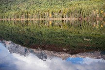 Mountains on the border of Alberta and British Columbia reflected in Yellowhead Lake.