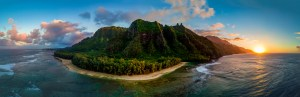 A Panoramic view of the Napali cliffs and coast at sunset in Hawaii.