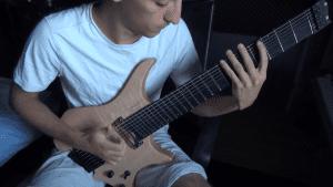 Belio playing 8-string slap guitar