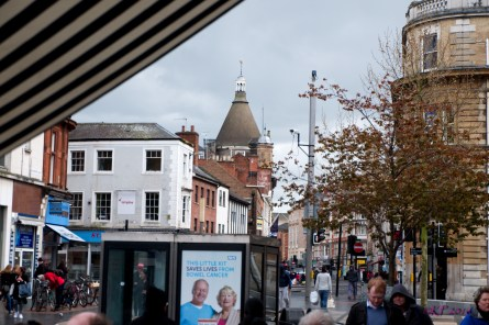 I love this view of Granby Street from the falafal stand at Gallowtree Gate, in part because of the white lettering advertising Fox & Son in the orange brick of the turret just in front of the Victoria Coffee House roof. This intersection, where the pedestrian area of Gallowtree Gate meets the one way systems of Horsefair Street and Granby Street is always busy during the day and into the evening.