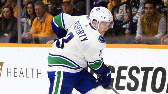 Canucks re-sign trio to two-way contracts
