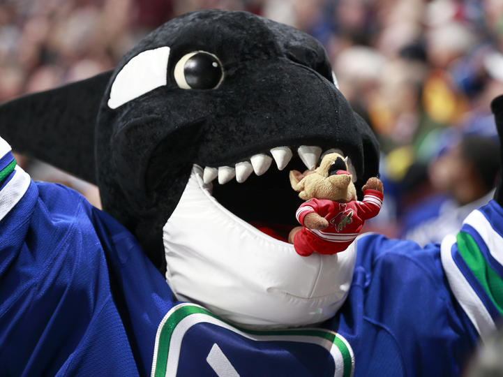 Offense-schmoffense when push comes to shove, just eat your opponent.  (Photo Courtesy canucks.nhl.com)