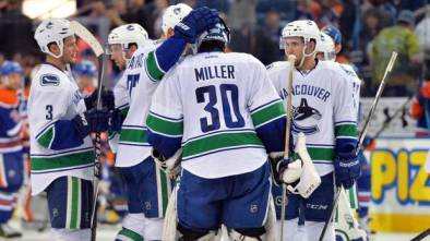 Ryan Miller celebrates his 30th career shutout with teammates on October 17, 2014 (photo by Steve Alkok)