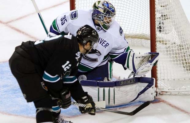 Cory Schneider of the Vancouver Canucks vs Patrick Marleau of the San Jose Sharks