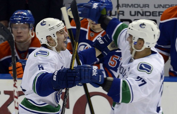 Chris Tanev of the Vancouver Canucks celebrates his first career NHL goal - an OT winner against the Edmonton Oilers.