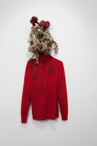 """Sister,"" 2011. Anicka Yi (Korean, b. 1971). Tempura-fried flowers, cotton turtleneck; dimensions variable. Collection Jay Gorney and Tom Heman, New York. Photo courtesy of 47 Canal, New York."