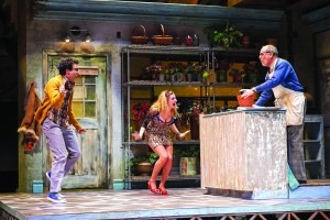 "Ari Butler, from left, as Seymour, Lauren Molina as Audrey and Larry Cahn as Mr. Mushnik in ""Little Shop of Horrors."" | PHOTO / Roger Mastroianni"