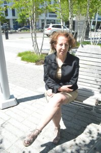 Jill Snyder, executive director of the Museum of Contemporary Art Cleveland, enjoys the sun on Toby's Plaza outside of the museum in Uptown. PHOTO | Carlo Wolff