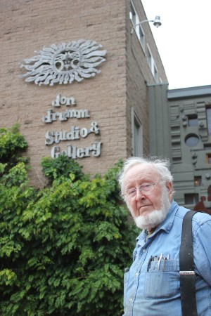 Sculptor Don Drumm stands outside his Akron studio and gallery.