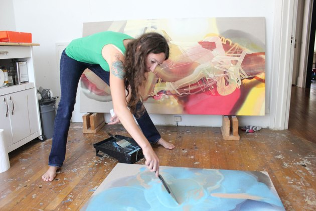 "Dana Oldfather works on ""Frothing"" in late September at her home studio in Newburgh Heights."