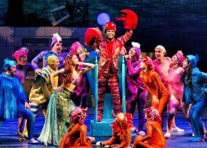 "Wesley Allen as Sebastian (center), Kathleen Rooney as Ariel (left center), and the ensemble of ""The Little Mermaid"". Photo | Kathy Sandham"