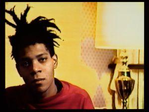 1. Tamra Davis_Basquiat Still Still from A Conversation with Basquiat, 2006. Tamra Davis (American, b. 1962). 23 min., 22 sec. © Tamra Davis. Courtesy of the artist. By permission of the Estate of Jean-Michel Basquiat, all rights reserved. Photo: Jonathan Dorado, Brooklyn Museum