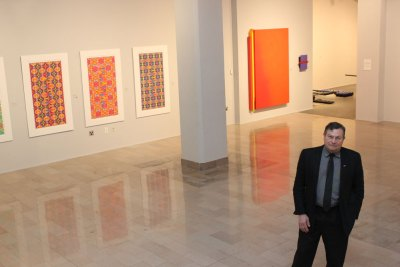 "Director and chief curator Robert Thurmer inside The Galleries of CSU during its spring exhibition, ""The Curious Case of Color."""