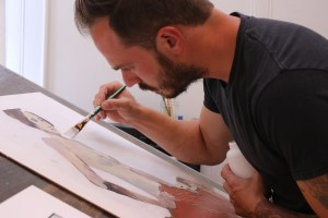 "Sweeney works on a new piece, ""Gold,"" in his studio."