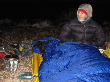 Waiting for dinner in our cozy 2-person down sleeping bag.