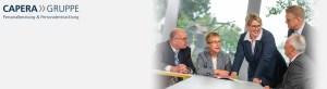 Personalberaterin Andrea Förster im Kreis von Kollegen