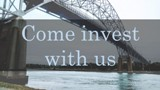 "Picture of the Bourne Bridge in Bourne, MA with ""Come Invest with us"""