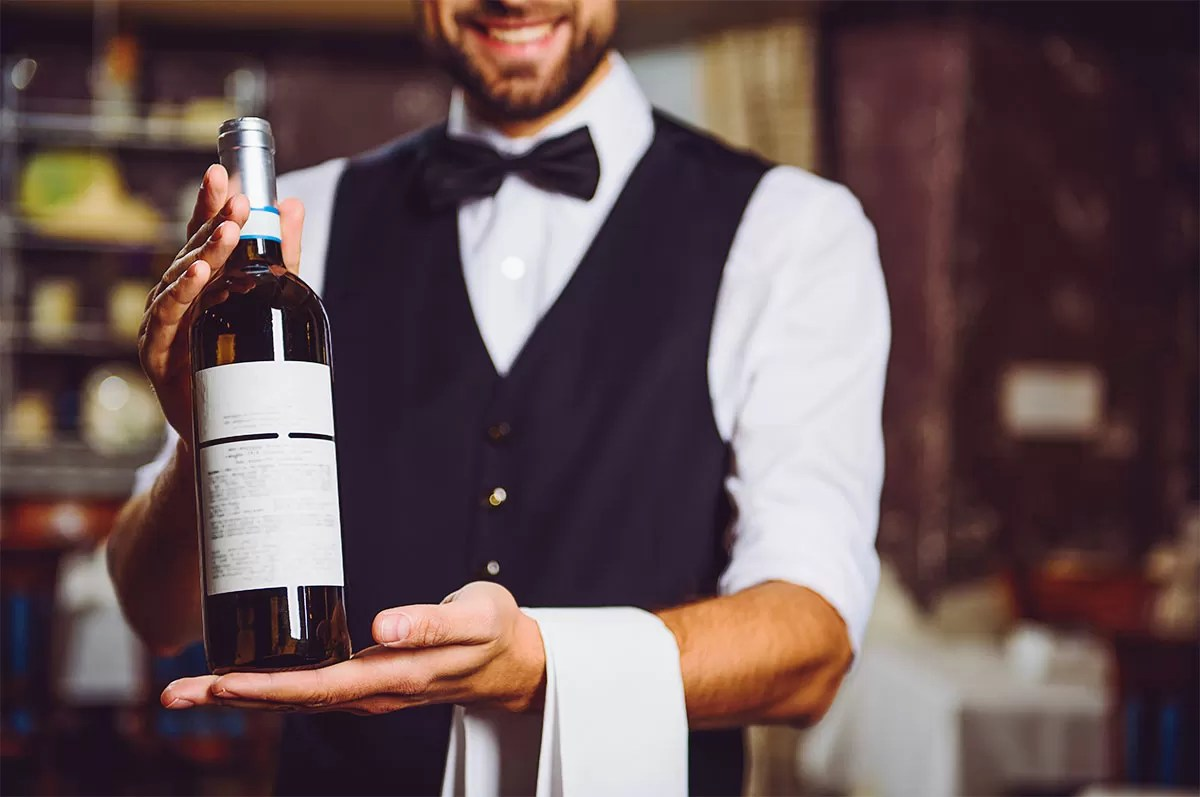 Sommelier Serving Wine