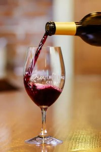 South Stage Cellars: Pouring Red Wine into Glass