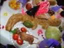 Un apetitoso cuy con todos los complementos para una ch'anka esperan al difunto