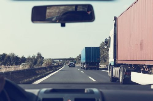 Trucks driving on a highway - we pick the fastest route to deliver moving bins to you