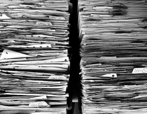 Paperwork outside of plastic bins for packing your office
