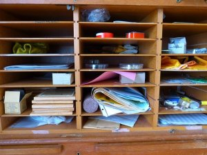 Shelves with things to empty out to produce less waste while moving.
