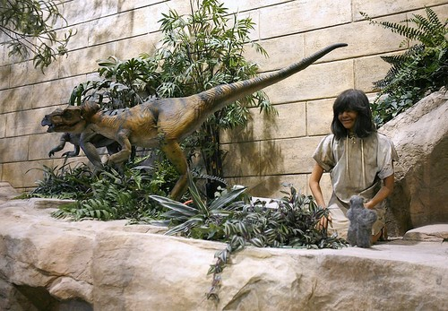 """A """"tame"""" dinosaur housepet roams the diorama, looking for a toddler to """"play"""" with."""