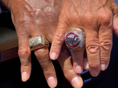 Mann and Leonsis show off their rings.