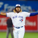 TORONTO, ONTARIO - SEPTEMBER 23: Vladimir Guerrero Jr. #27 of the Toronto Blue Jays gestures against the Baltimore Orioles in the first inning during their MLB game at the Rogers Centre on September 23, 2019 in Toronto, Canada. (Photo by Mark Blinch/Getty Images)