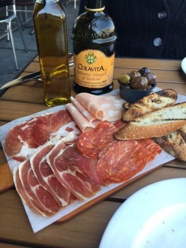The lovely salumi platter- selection of our cured cuts/olives/bread Prosciutto di Parma/soppressata/coppa mortadella w/pistacchios