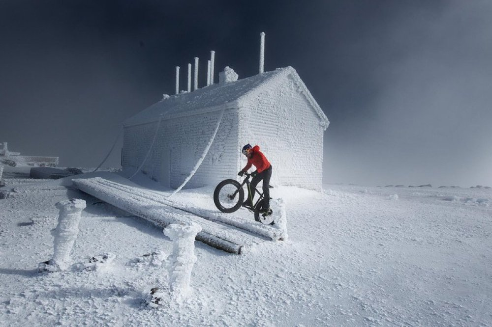 Tim Johnson climbs Mount Washington on his fat bike for the first winter ascent of the auto road on a bicycle on Mount Washington in Gorham, NH on February 2, 2016