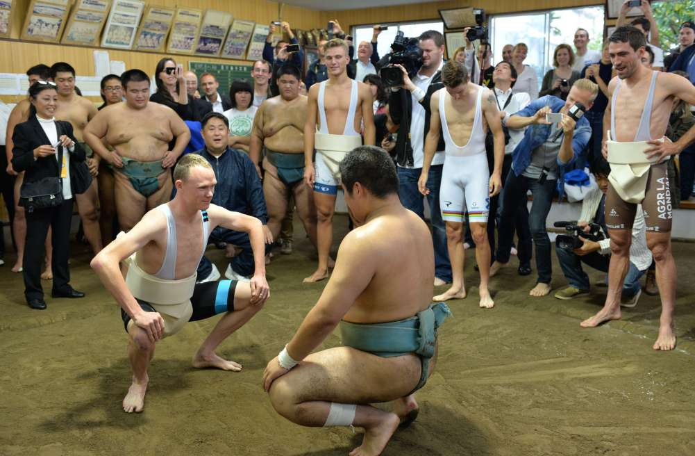 Christopher Froome (L, front), British road racing cyclist and winner of the 2013 Tour de France, wearing a mawashi (sumo-belt) participates in sumo training as part of an exchange program with the Saitama citizen on October 25, 2013 ahead of the Saitama criterium races. Cyclists including Tour de France winner Chris Floome will compete at criterium races in Saitama, suburban Tokyo on October 26. AFP PHOTO / KAZUHIRO NOGIKAZUHIRO NOGI/AFP/Getty Images