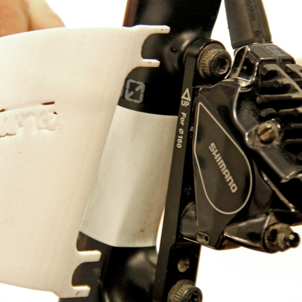 Tune_project-Disc-Sheath_lightweight-160mm-road-peloton-disc-brake-rotor-safety-cover-guard_adjustable-direct-mount-fit