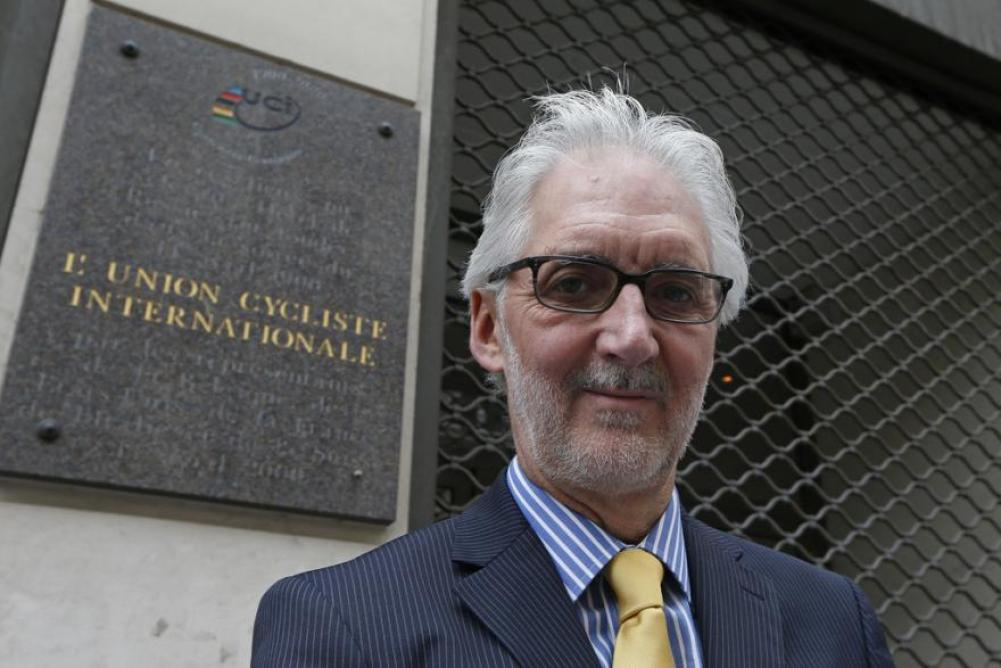 Brian Cookson in Paris by UCI plaque (source Brian Cookson Images, Flickr)