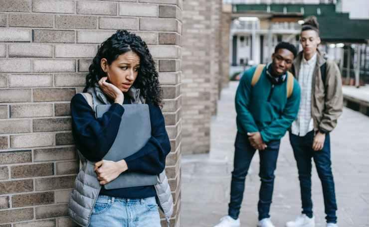 diverse classmates bullying hispanic student in university