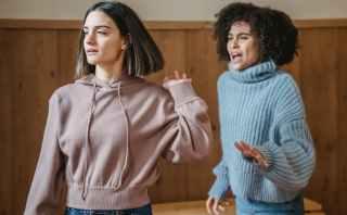 multiethnic women fighting in room