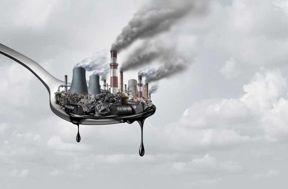 Pollution in food and toxic chemical eat, surreal, surrealistic, idea, contaminants that people ingest as a health and safety concept as a spoon  with polluting industry dripping with petroleum as a 3D illustration.