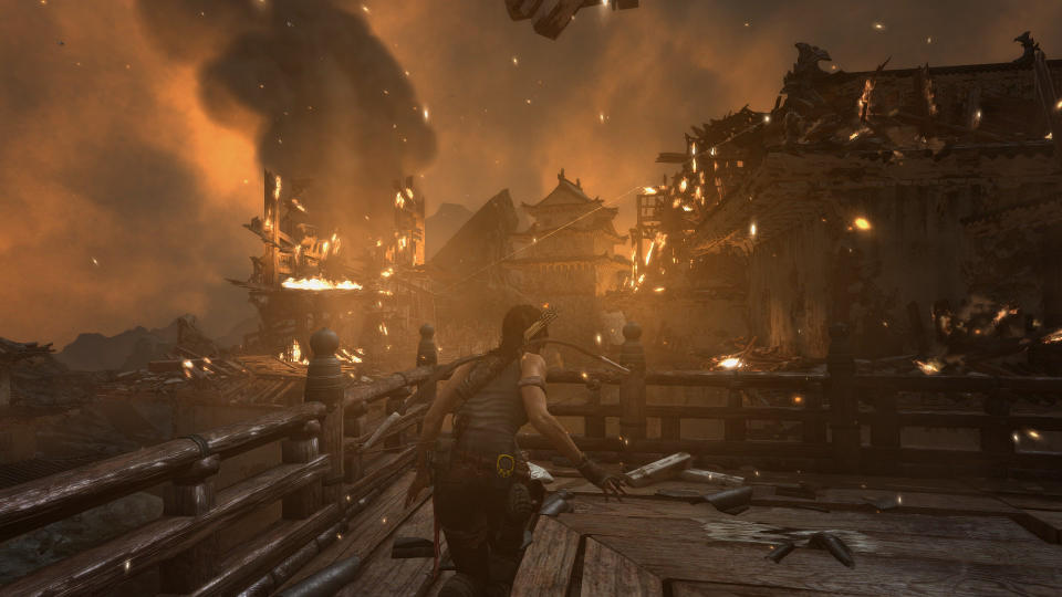 A huge gunfight surrounded by burning buildings