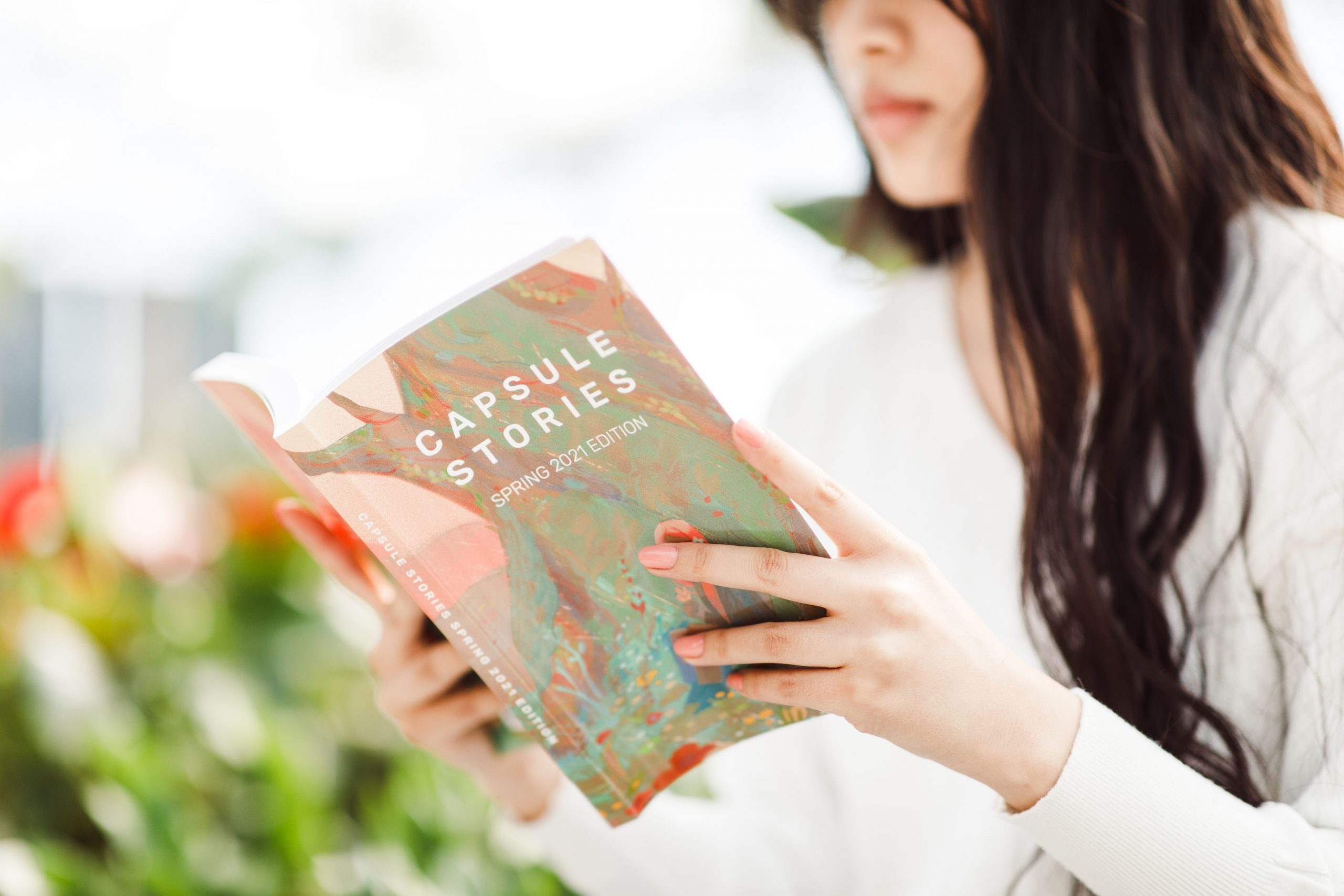 girl holding capsule stories spring 2021 edition