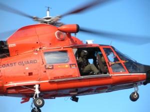 orange chopper in a blue sky