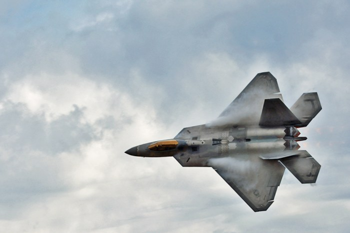 U.S.A.F. F-22 Raptor. Condensation on wings due to high speed in moist air.