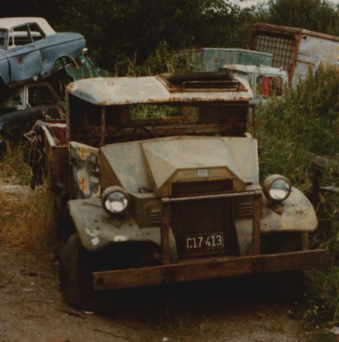 Derelict army truck in junk yard.