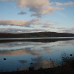 Clouds reflecting on still waters of scottish lake. Loch Rannoch, Perthshire, Scotland 2
